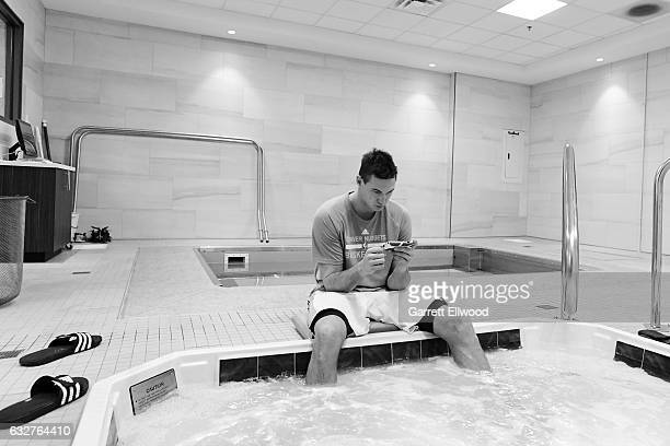 Danilo Gallinari of the Denver Nuggets gets treatment before the game against the Utah Jazz on January 24, 2017 at the Pepsi Center in Denver,...