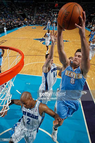 Danilo Gallinari of the Denver Nuggets goes to the basket against double block during an NBA game between the Denver Nuggets and the New Orleans...