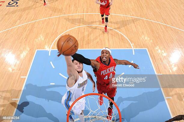 Danilo Gallinari of the Denver Nuggets goes to the basket against Dante Cunningham of the New Orleans Pelicans on March 1 2015 at the Pepsi Center in...