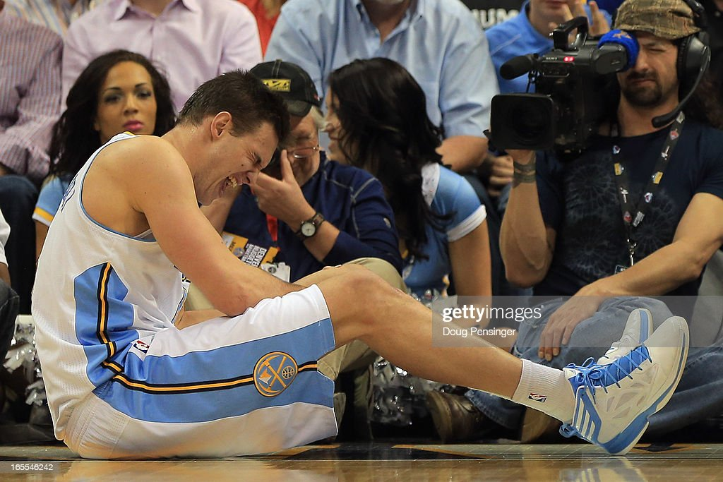 Danilo Gallinari #8 of the Denver Nuggets grimaces as he injures his left leg and was forced to leave the game against the Dallas Mavericks at the Pepsi Center on April 4, 2013 in Denver, Colorado.