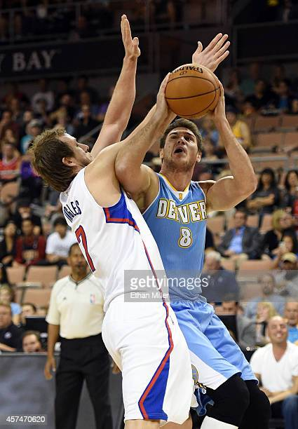 Danilo Gallinari of the Denver Nuggets shoots against Joe Ingles of the Los Angeles Clippers during their preseason game at the Mandalay Bay Events...