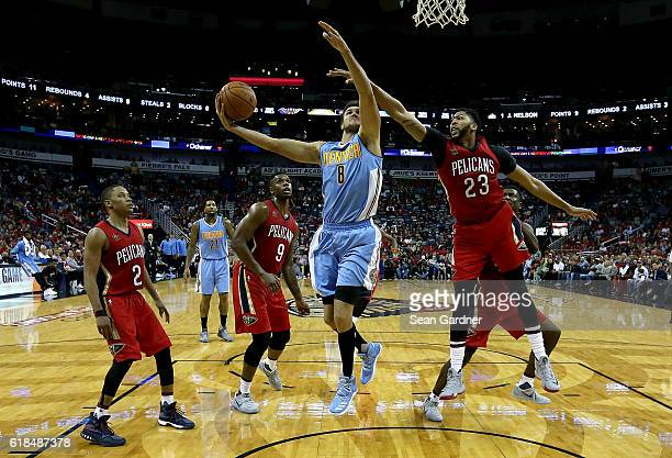 Danilo Gallinari of the Denver Nuggets shoots over Anthony Davis of the New Orleans Pelicans at the Smoothie King Center on October 26 2016 in New...