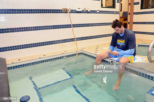 Danilo Gallinari of the Denver Nuggets soaks his feet before playing against the Miami Heat on November 15 2012 at the Pepsi Center in Denver...
