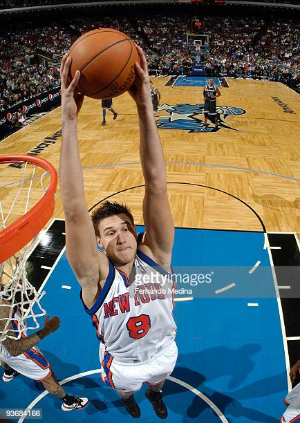 Danilo Gallinari of the New York Knicks pulls down a rebound against the Orlando Magic during the game on December 2 2009 at Amway Arena in Orlando...