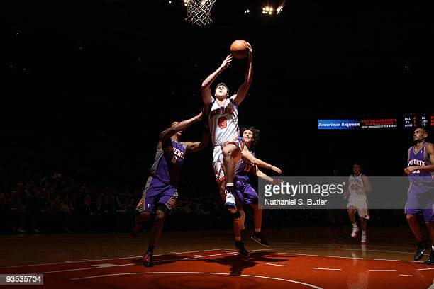 Danilo Gallinari of the New York Knicks shoots against Channing Frye and Steve Nash of the Phoenix Suns on December 1, 2009 at Madison Square Garden...