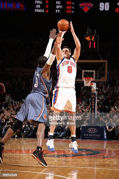 Danilo Gallinari of the New York Knicks shoots against Gerald Wallace of the Charlotte Bobcats on January 7 2010 at Madison Square Garden in New York...