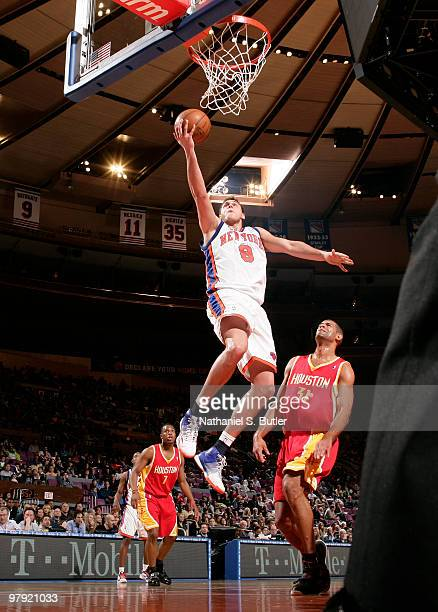 Danilo Gallinari of the New York Knicks shoots against Shane Battier of the Houston Rockets on March 21, 2010 at Madison Square Garden in New York...