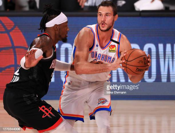 Danilo Gallinari of the Oklahoma City Thunder drives the ball against Robert Covington of the Houston Rockets during the second quarter in Game Seven...