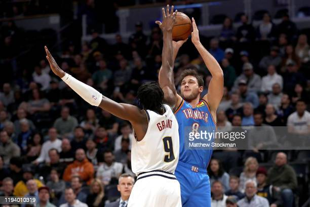 Danilo Gallinari of the Oklahoma City Thunder puts up a shot over Jerami Grant of the Denver Nuggets in the second quarter at Pepsi Center on...