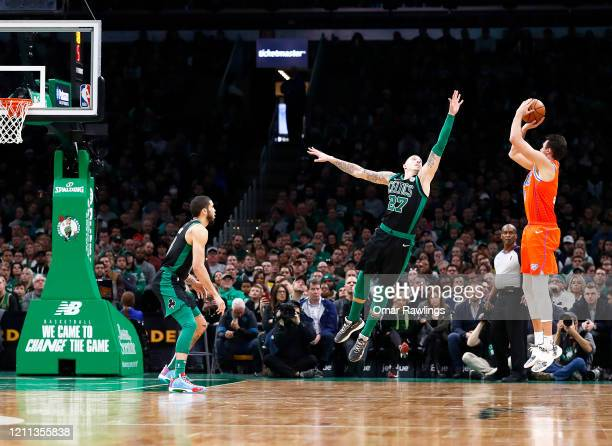 Danilo Gallinari of the Oklahoma City Thunder shoots over Daniel Theis of the Boston Celtics during the fourth quarter of the game at TD Garden on...