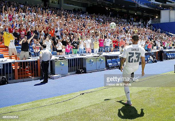 Danilo gives a ball to the fans during his official presentation as a new Real Madrid player at Estadio Santiago Bernabeu on July 9 2015 in Madrid...