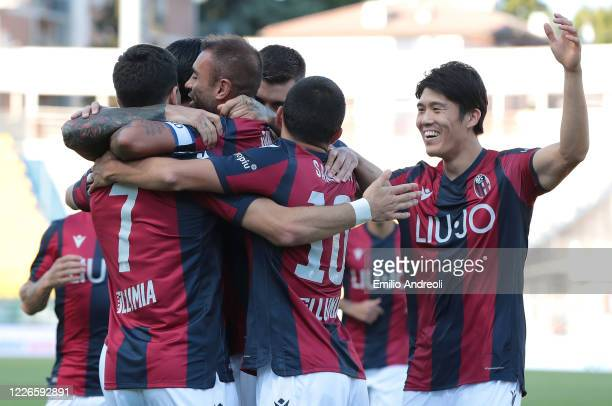 Danilo Larangeira of Bologna FC celebrates with his teammates after scoring the opening goal during the Serie A match between Parma Calcio and...