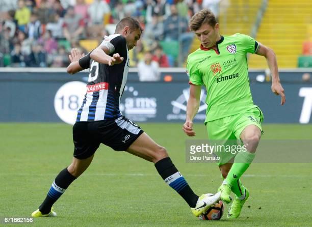 Danilo Larangeira of Udinese Calcio competes with Nicolo' Barella of Cagliari Calcio during the Serie A match between Udinese Calcio and Cagliari...