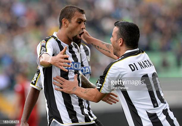 Danilo Larangeira of Udinese celebrates with Antonio Di Natale after scoring his opening goal during the Serie A match between Udinese Calcio and...