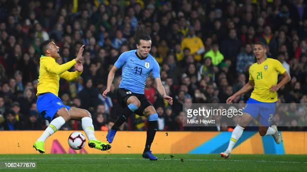 Danilo Luiz da Silva of Brazil is fouled by Diego Laxalt of Uruguay to conceed a penalty during the International Friendly between Brazil and Uruguay...