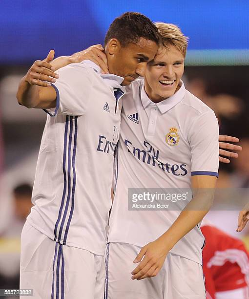 Danilo Luiz Da Silva of Real Madrid celebrates his first goal with teammate Martin Odegaard during the International Champions Cup match between FC...