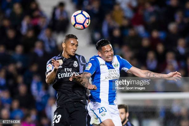 Danilo Luiz Da Silva of Real Madrid fights for the ball with Luciano Neves of Deportivo Leganes during their La Liga match between Deportivo Leganes...