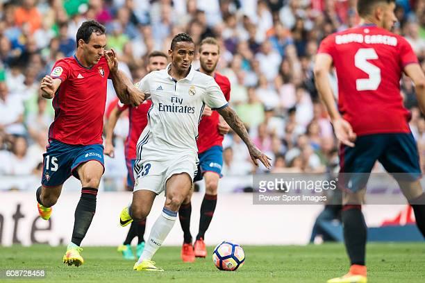 Danilo Luiz da Silva of Real Madrid fights for the ball with Unai Garcia of Osasuna during the La Liga match between Real Madrid and Osasuna at the...