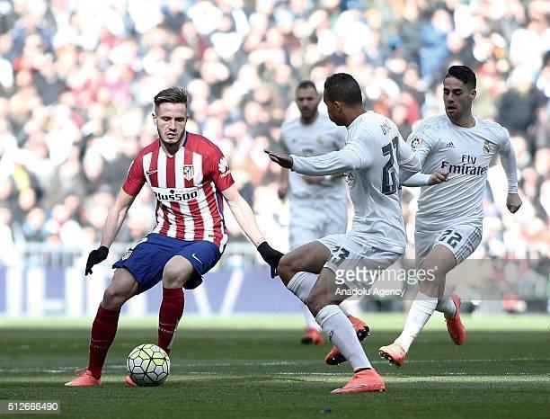 Danilo Luiz da Silva of Real Madrid in action against Saul Niguez of Club Atletico de Madrid during the La Liga match between Real Madrid CF and Club...
