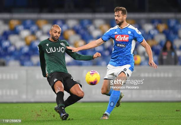 Danilo of Bologna FC vies with Fernando Llorente of SSC Napoli during the Serie A match between SSC Napoli and Bologna FC at Stadio San Paolo on...
