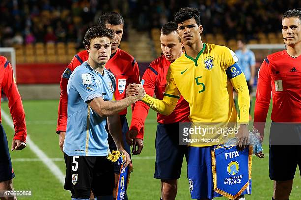 Danilo of Brazil and Nahitan Nandez of Uruguay take part in the FIFA 'Handshake for Peace' during the FIFA U20 World Cup New Zealand 2015 Round of 16...