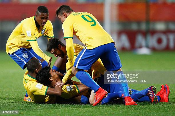 Danilo of Brazil celebrates with team mates after he scores his teams first goal of the game during the FIFA U20 World Cup New Zealand 2015 Group E...