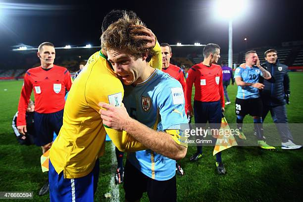 Danilo of Brazil comforts Nahitan Nandez of Uruguay as Rodrigo Amaral walks by after the FIFA U20 World Cup New Zealand 2015 Round of 16 match...