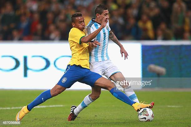 Danilo of Brazil competes the ball with Angel Di Maria of Argentina during Super Clasico de las Americas between Argentina and Brazil at Beijing...