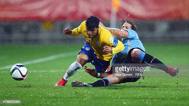 Danilo of Brazil is challenged by Diego Poyet of Uruguay during the FIFA U20 World Cup New Zealand 2015 Round of 16 match between Brazil and Uruguay...