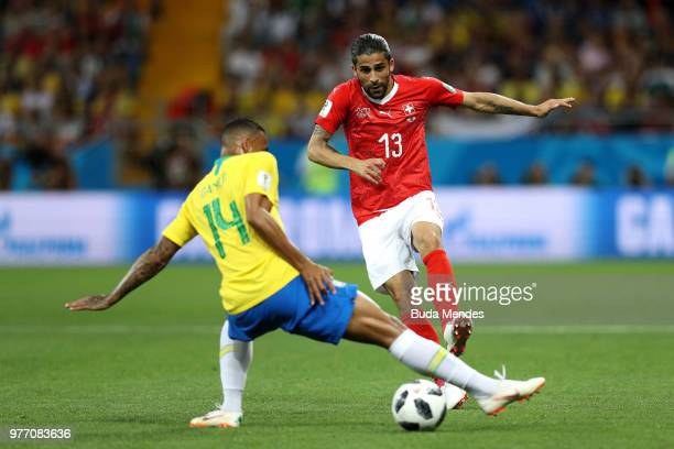 Danilo of Brazil tackles Ricardo Rodriguez of Switzerland during the 2018 FIFA World Cup Russia group E match between Brazil and Switzerland at...