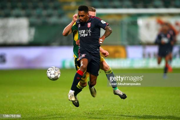 Danilo of FC Twente battles for the ball with Boy Kemper of ADO Den Haag during the Dutch Eredivisie match between ADO Den Haag and FC Twente at Cars...