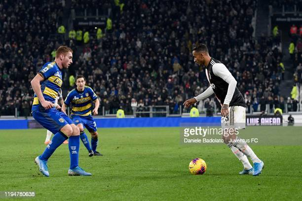 Danilo of Juventus competes for the ball with Dejan Kulusevski of Parma Calcio during the Serie A match between Juventus and Parma Calcio at Allianz...