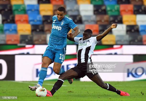 Danilo of Juventus competes for the ball with Ken Sema of Udinese Calcio during the Serie A match between Udinese Calcio and Juventus at Stadio...