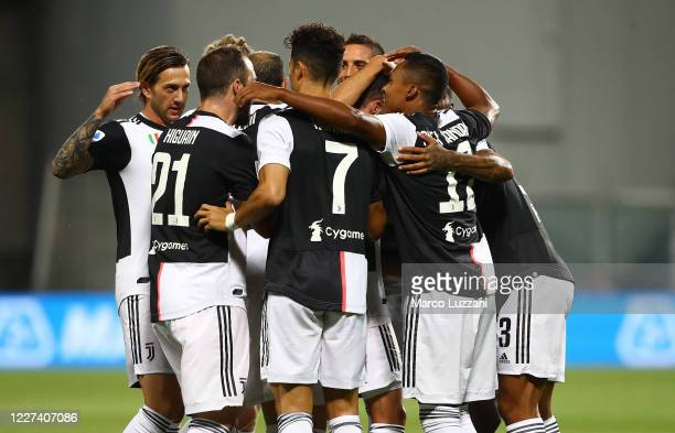 Danilo of Juventus FC celebrates with his teammates after scoring the opening goal during the Serie A match between US Sassuolo and Juventus at Mapei...