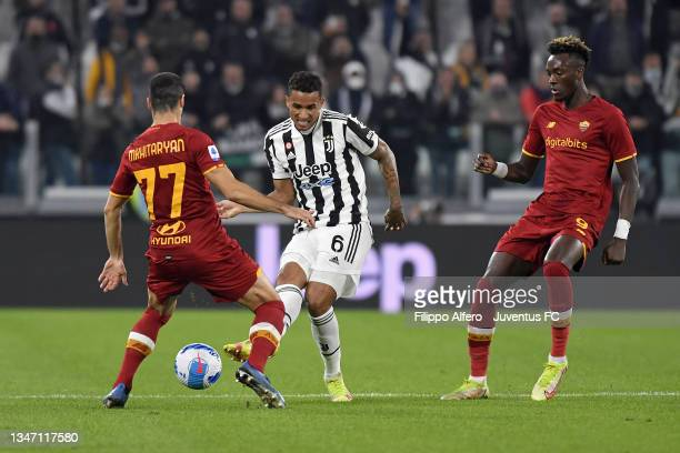 Danilo of Juventus is challenged by Henrikh Mkhitaryan of AS Roma during the Serie A match between Juventus and AS Roma at Allianz Stadium on October...