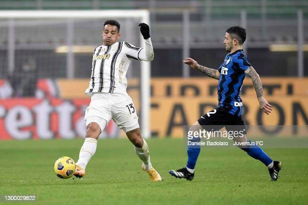 Danilo of Juventus is challenged by Stefano Sensi of FC Internazionale during the Coppa Italia semi-final match between FC Internazionale and...