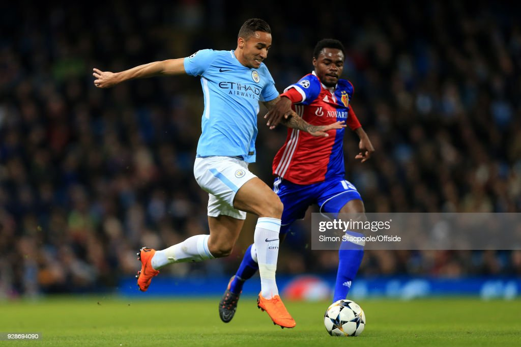 Danilo of Man City battles with Dimitri Oberlin of Basel during the UEFA Champions League Round of 16 Second Leg match between Manchester City and FC Basel at the Etihad Stadium on March 7, 2018 in Manchester, England.