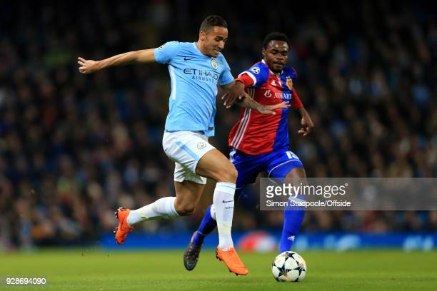 Danilo of Man City battles with Dimitri Oberlin of Basel during the UEFA Champions League Round of 16 Second Leg match between Manchester City and FC...