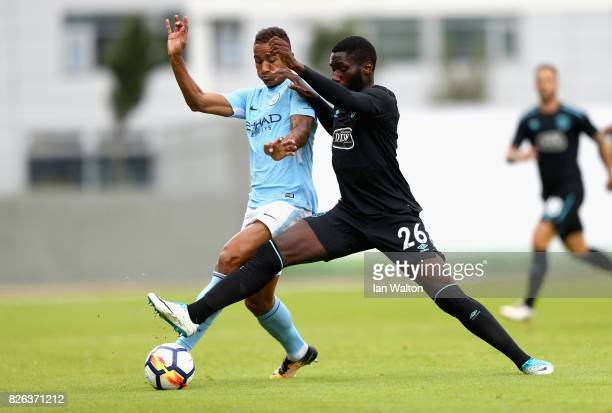 Danilo of Manchester City and Arthur Masuaku of West Ham United battle for possession during a Pre Season Friendly between Manchester City and West...