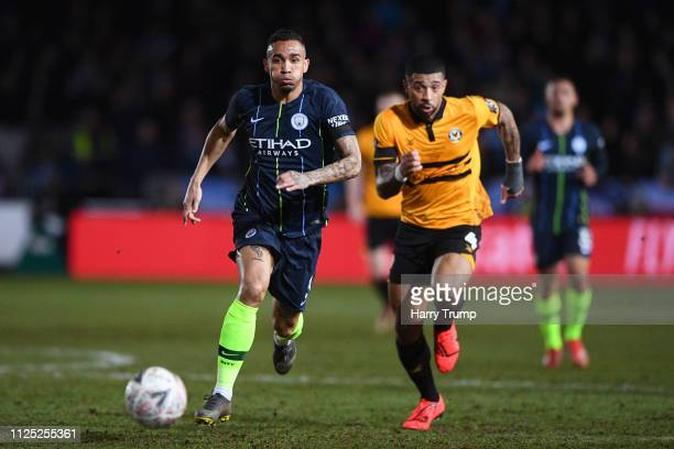 Danilo of Manchester City and Joss Labadie of Newport County compete for the ball during the FA Cup Fifth Round match between Newport County AFC and...