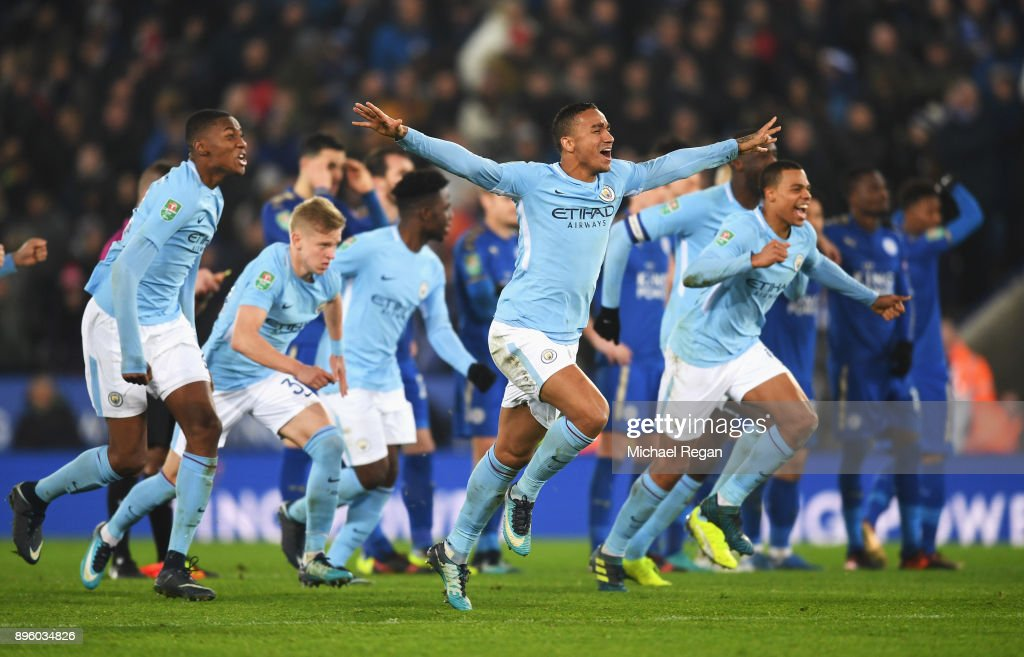 Danilo of Manchester City and team mates celebrate shoot out victory during the Carabao Cup Quarter-Final match between Leicester City and Manchester City at The King Power Stadium on December 19, 2017 in Leicester, England.