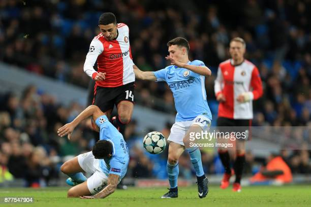 Danilo of Manchester City and teammate Phil Foden combine to tackle Bilal Basacikoglu of Feyenoord during the UEFA Champions League match between...