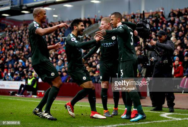 Danilo of Manchester City celebrates after scoring his sides first goal with teammates Vincent Kompany of Manchester City Ilkay Gundogan of...