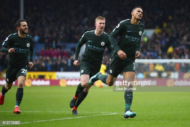 Danilo of Manchester City celebrates after scoring his sides first goal with teammates Kevin De Bruyne of Manchester City and Bernardo Silva of...
