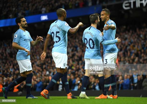 Danilo of Manchester City celebrates after scoring his sides fist goal with his Manchester City team mates during the Premier League match between...