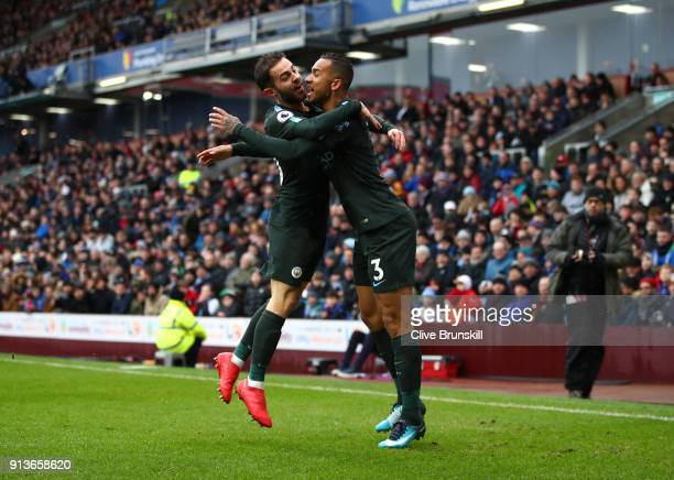 Danilo of Manchester City celebrates scoring the first goal with Bernardo Silva of Manchester City during the Premier League match between Burnley...