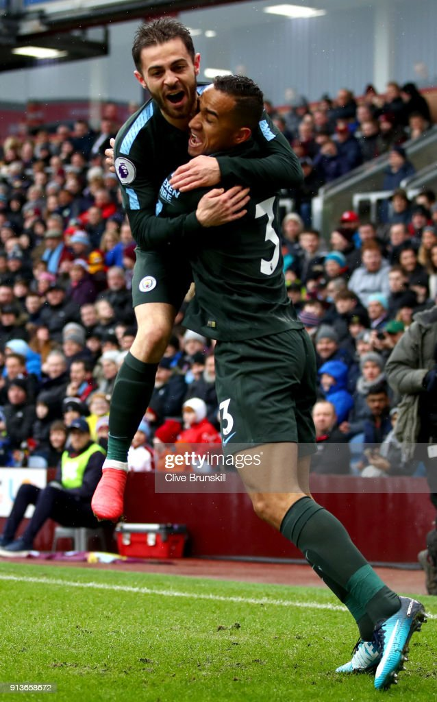 Danilo of Manchester City celebrates scoring the first goal with Bernardo Silva of Manchester City during the Premier League match between Burnley and Manchester City at Turf Moor on February 3, 2018 in Burnley, England.