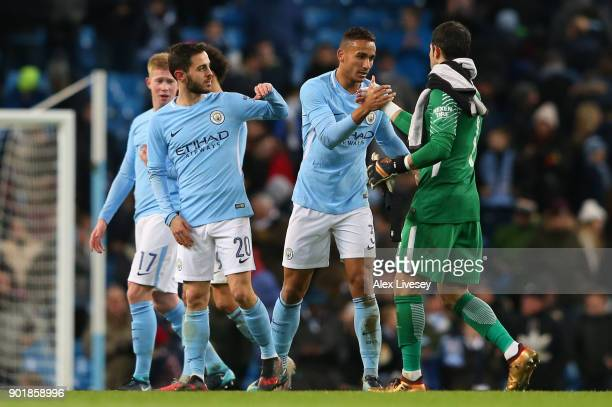 Danilo of Manchester City celebrates with Claudio Bravo after the The Emirates FA Cup Third Round match between Manchester City and Burnley at Etihad...