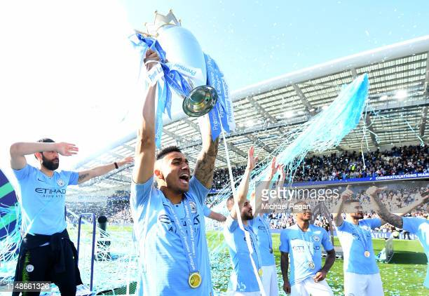 Danilo of Manchester City celebrates with the Premier League Trophy after winning the title following the Premier League match between Brighton Hove...