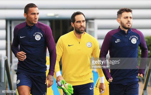 Danilo of Manchester City Claudio Bravo of Manchester City and David Silva of Manchester City all walk out prior to a training session at Etihad...